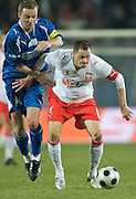 (L) ALEKSANDAR VUKOVIC (LEGIA) & (R) JACEK KRZYNOWEK (POLAND) DURING FRIENDLY SOCCER MATCH BETWEEN POLAND NATIONAL TEAM AND ORANGE EXTRALEAGUE'S FORIGNERS IN SZCZECIN, POLAND..SZCZECIN , POLAND , MARCH 11, 2008.( PHOTO BY ADAM NURKIEWICZ / MEDIASPORT )