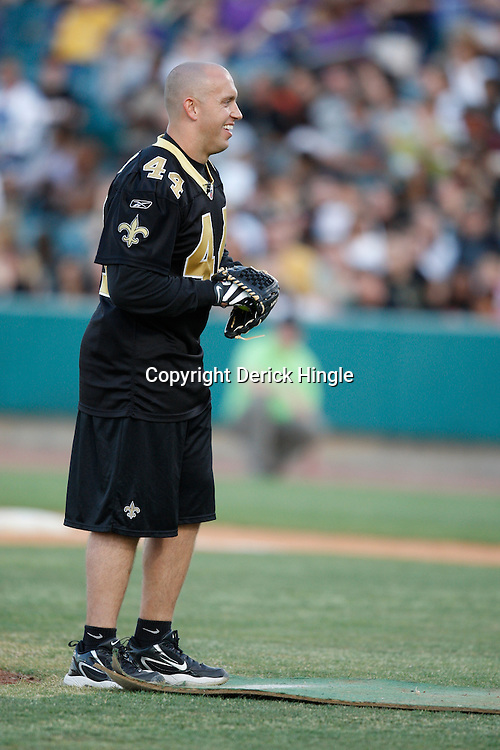 Apr 28, 2010; Metairie, LA, USA; Heath Evans (44) pitches during the Heath Evans Foundation charity softball game featuring teammates of the Super Bowl XLIV Champion New Orleans Saints at Zephyrs Field.  Mandatory Credit: Derick E. Hingle-US-PRESSWIRE.