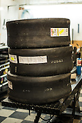 A stack of motorcycle drag racing slicks waiting mounting at Tombo Racing shop in Oklahoma City.