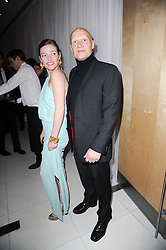 CAMILLA RUTHERFORD and DOMINIC BURNS at a party to celebrate Lancome's 10th anniversary of sponsorship of the BAFTA's in association with Harper's Bazaar magazine held at St.Martin's Lane Hotel, London on 19th February 2010.