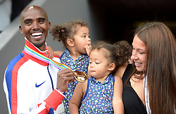 File photo dated 17-08-2014 of Great Britain's Mo Farah poses with wife Tania and daughters Aisha and Amani after winning the Men's 5000m Final during day six of the 2014 European Athletics Championships at the Letzigrund Stadium, Zurich.