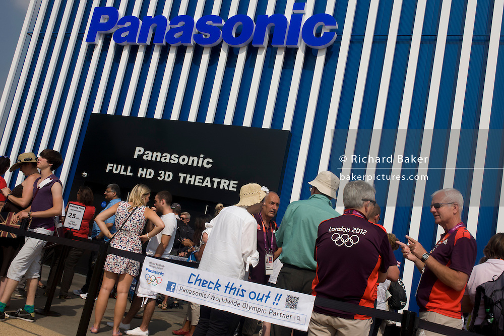 Spectators queue outside Panasonic's HD 3D theatre in the Olympic Park during the London 2012 Olympics. Panasonic produced the world's first 3D Live Games in co-operation with the Olympic Broadcasting Service (OBS). Their Full HD 3D Theatre, with the world's largest 152-inch plasma display screens, will showcase celebratory moments of the Games in live 3D, including highlights of the Opening Ceremony