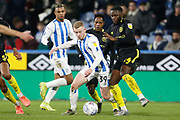 Lewis O'Brien of Huddersfield Town goes past Josh Dasilva of Brentford  during the EFL Sky Bet Championship match between Huddersfield Town and Brentford at the John Smiths Stadium, Huddersfield, England on 18 January 2020.