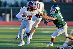 {BLOOMINGTON, IL: Tae'Shawn Gibbs escapes the grasp of Francis Urbanski during a college football game between the IWU Titans  and the Wheaton Thunder on September 15 2018 at Wilder Field in Tucci Stadium in Bloomington, IL. (Photo by Alan Look)