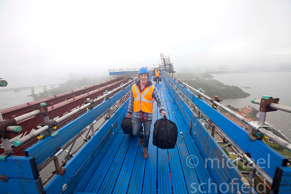 Bwani Junction, the Edinburgh based band, made music history by becoming the first group to play on the Forth Rail Bridge, they played on the highest point of the 122-year-old structure. Pic of Jack Fortheringham (drums) on arrival on the top of the bridge..©Michael Schofield.