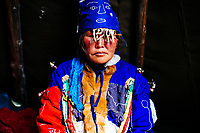 A Tsaatan woman in traditional shaman dress in the East Taiga, in northern Mongolia.