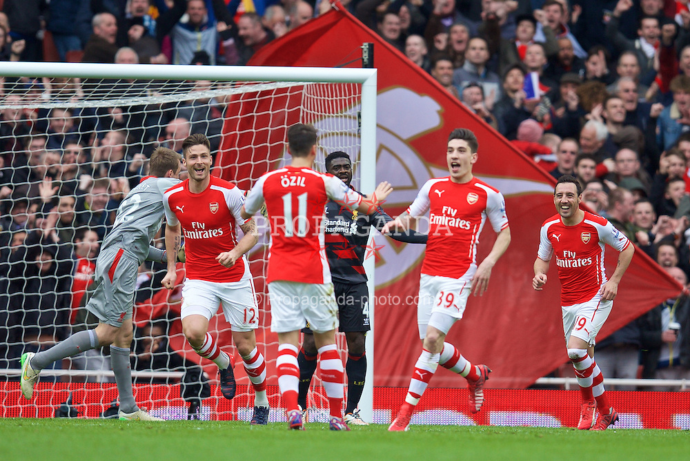 LONDON, ENGLAND - Saturday, April 4, 2015: Arsenal's Hector Bellerin celebrates scoring the first goal against Liverpool during the Premier League match at the Emirates Stadium. (Pic by David Rawcliffe/Propaganda)