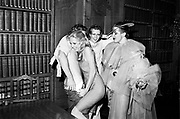 Paul Golding and Libby Manners looking on as Katie  removes trousers in the library. Piers Gaveston. rhodes House. Oxford. © Copyright Photograph by Dafydd Jones 66 Stockwell Park Rd. London SW9 0DA Tel 020 7733 0108 www.dafjones.com