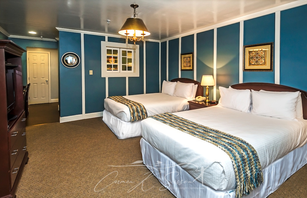 """A soothing palette of blue and gold greets guests in one of the remodeled rooms at University Inn, a family-owned hotel located near Emory University in Atlanta, Georgia, May 29, 2014. The inn opened in January 1971 and offers 60 rooms to meet the lodging needs of University parents and other Atlanta visitors. It was featured on the Travel Channel's """"Hotel Impossible,"""" May 26, 2014. (Photo by Carmen K. Sisson/Cloudybright)"""