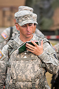 A male Drill Sergeant candidate reads from his manual at the US Army Drill Instructors School Fort Jackson during formation September 26, 2013 in Columbia, SC. While 14 percent of the Army is women soldiers there is a shortage of female Drill Sergeants.