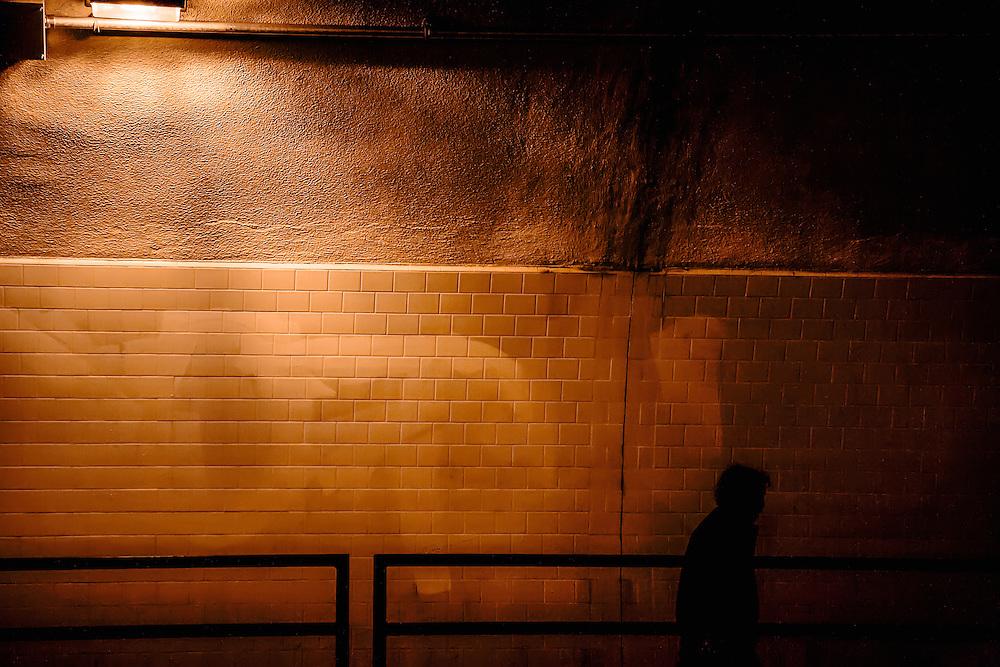 Woman walks Stockton Tunnel. San Francisco, CA. Copyright 2008 Reid McNally.