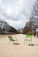 Two  Green Chairs on a path In Paris, France