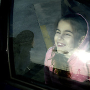 Annabelle Costanzo smiles as she feels the rays of the sun through a car window.  She also was able to detect some light after having surgery on her eyes.  Annabelle was born blind, and there is still hope that she will someday see.