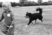 A kid and dog, at Glastonbury, 1989.