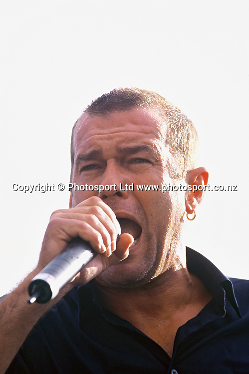 Australian singer Jimmy Barnes performs at the Hurricanes v Stormers game, 9 March 2001.<br /> Copyright photo: www.photosport.co.nz
