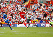 Tjaronn Chery fires one goal-wards forcing a save from Stephen Henderson during the Sky Bet Championship match between Charlton Athletic and Queens Park Rangers at The Valley, London, England on 8 August 2015. Photo by Andy Walter.