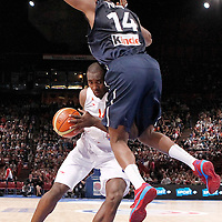 15 July 2012: Serge Ibaka of Team Spain is fouled by Ronny Turiaf of Team France during a pre-Olympic exhibition game won 75-70 by Spain over France, at the Palais Omnisports de Paris Bercy, in Paris, France.