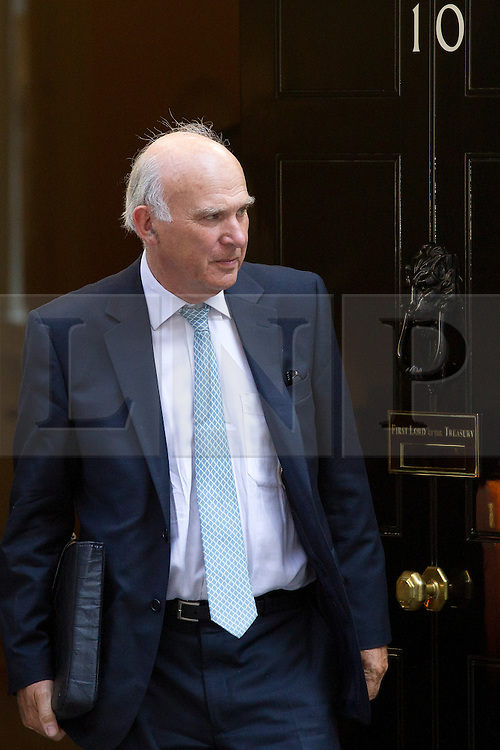 "© Licensed to London News Pictures. 29/08/2013. London, UK. Business Secretary Vince Cable leaves a meeting of the British cabinet on Downing Street in London today (29/08/2013) as a recalled British Parliament prepares to debate the possibility of ""direct"" military action over recent reports an alleged chemical weapons attack in Syria. Photo credit: Matt Cetti-Roberts/LNP"