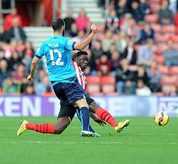 Stoke's Marc Wilson is tackled by Southampton's Victor Wanyama - Photo mandatory by-line: Dougie Allward/JMP - Mobile: 07966 386802 - 25/10/2014 - SPORT - Football - Southampton - ST Mary's Stadium - Southampton v Stoke - Barclays Premier League
