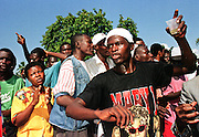 07 FEB 96 - PORT AU PRINCE, HAITI: Haitians sing and dance for newly installed Haitian president Rene Preval in front of the Haitian Legislative Palace Wednesday morning, Feb 7. For the first time in Haiti's history, one democratically elected president succeeded another Wednesday, when the tumultous term of President Jean Bertrand Aristide came to an end.   .PHOTO BY JACK KURTZ