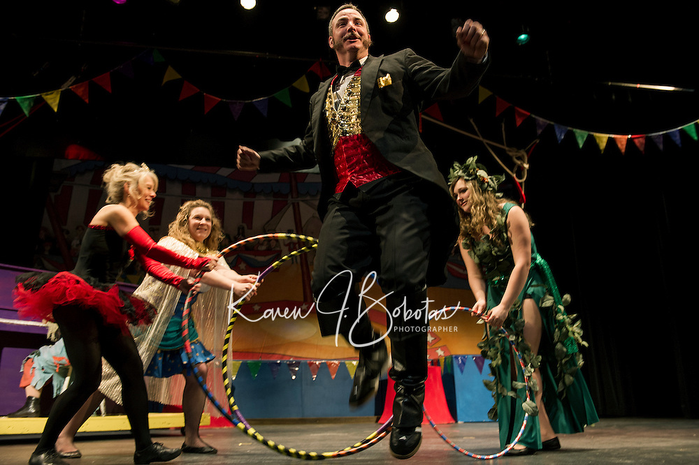 """Chris Fernandez as the Ring Master jumps through hoops on stage during dress rehearsal for Streetcar Company's production of """"Barnum"""" the circus musical.  (Karen Bobotas/for the Laconia Daily Sun)"""