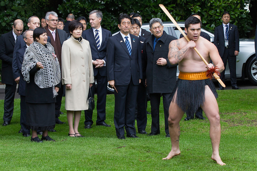 His Excellency Shinzo Abe, Prime Minister of Japan is welcomed by Prime Minister John Key and a traditional Maori welcome as he starts an official visit to New Zealand, Government House, Auckland, New Zealand, Monday, July 07, 2014.  Credit:SNPA / David Rowland