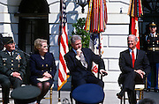 President Bill Clinton during an event on the Chemical Weapons Ban treaty at the White House event April 4,1997 in Washington, DC. Secretary of State Madeleine Albright and James Baker listen
