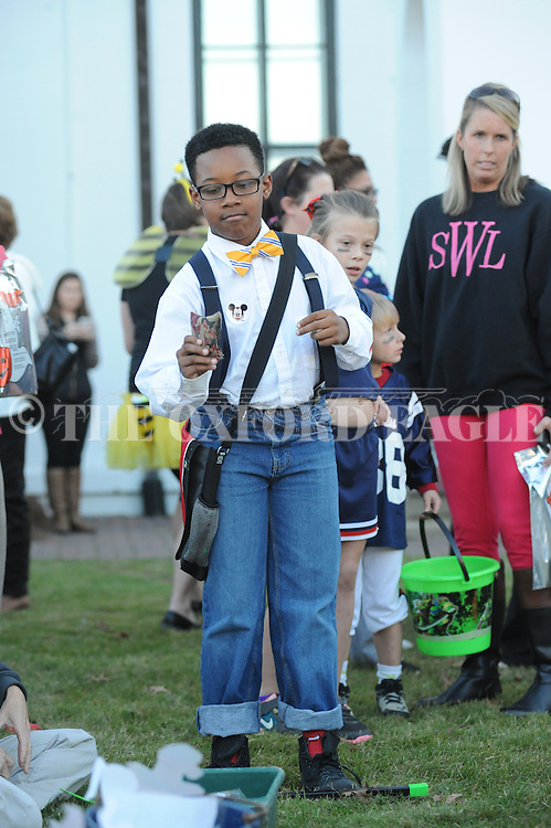 Xyland Tyson tosses a beanbag during the Halloween Spooktacular at the Lafayette County Courthouse in Oxford, Miss. on Thursday, October 30, 2014.