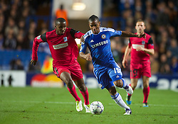 LONDON, ENGLAND - Wednesday, October 19, 2011: Chelsea's Florent Malouda in action against Racing Genk's Khaleem Hyland during the UEFA Champions League Group E match at Stamford Bridge. (Photo by Chris Brunskill/Propaganda)