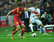 Montenegro's Miodrag Dzudovic and Robert Lewandowski of Poland during the FIFA World Cup 2014 group H qualifying football match of Poland vs Montenegro on September 6, 2013 in Warsaw, <br />