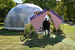 "© Licensed to London News Pictures. 05/09/2019. LONDON, UK. Exterior view of a ""Butterfly Biosphere"" in Grosvenor Square, Mayfair.  Setup by Bompas and Parr in association with King's College London and Butterfly Conservation, the aim is to make visitors more aware of the importance of pollinators and the ecosytem that the capital's 50 species of butterfly need to thrive.  The biosphere is open 5 to 15 September.  Photo credit: Stephen Chung/LNP"
