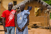 Kevin Kouassi Gallet and his father Hyacinthe Kouassi Koffi pose for a portrait in their hometown of Tano Akakro, Cote d'Ivoire on Saturday June 20, 2009.