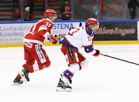 2020-02-12 | Ljungby, Sweden: Troja-Ljungby (51) Jonatan Nielsen and Huddinge IK (13) Dennis Nordström during the game between IF Troja / Ljungby and Huddinge IK at Ljungby Arena ( Photo by: Fredrik Sten | Swe Press Photo )<br /> <br /> Keywords: Ljungby, Icehockey, HockeyEttan, Ljungby Arena, IF Troja / Ljungby, Huddinge IK, fsth200212, ATG HockeyEttan, Allettan