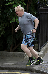© Licensed to London News Pictures. 18/07/2017. London, UK. Foreign Secretary Boris Johnson goes for a jog before attending cabinet wearing a t-shirt bearing French slogans. Photo credit: Peter Macdiarmid/LNP