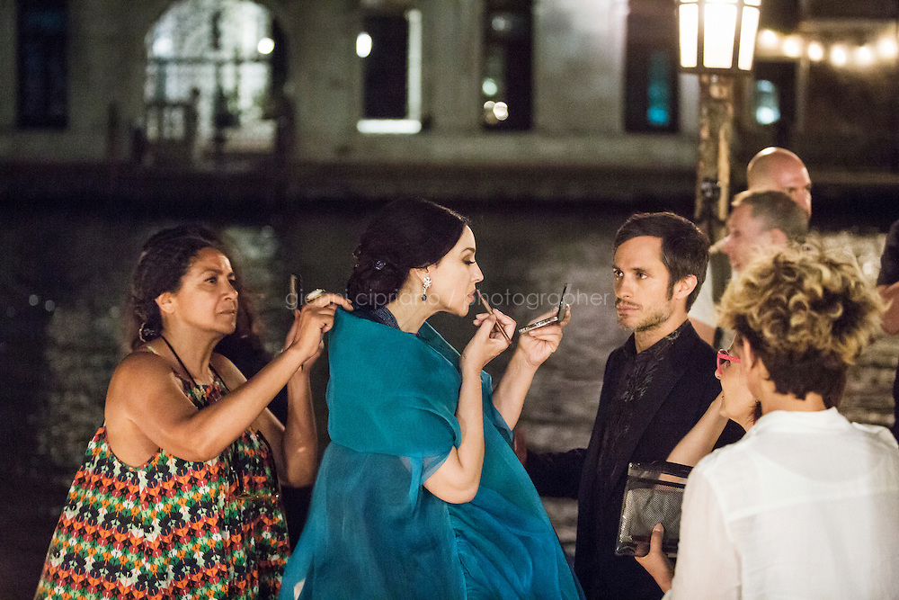 VENICE, ITALY - 13 JULY 2016: Actress Monica Bellucci (51) puts on make-up set on a set and barge with actor Gael Garcia Bernal (37, 2nd from right) before shooting a scene of an episode of the third season of &quot;Mozart in the Jungle&quot; on the Grand Canal in Venice, Italy, on July 13th 2016.<br /> <br /> Mozart in the Jungle is an award-winning television series produced by Picrow for Amazon Studios. The pilot was written by Roman Coppola, Jason Schwartzman, and Alex Timbers and directed by Paul Weitz. The story was inspired by Mozart in the Jungle: Sex, Drugs, and Classical Music, oboist Blair Tindall's 2005 memoir of her professional career in New York.