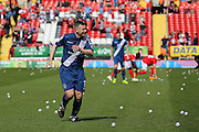Birmingham City defender, Paul Caddis (31) helping to clear the balls off the pitch after protest during the Sky Bet Championship match between Charlton Athletic and Birmingham City at The Valley, London, England on 2 April 2016. Photo by Matthew Redman.