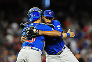 Apr. 29 2011; Phoenix, AZ, USA; Chicago Cubs catcher Geovany Soto (18) congratulates pitcher Carlos Marmol (49) after defeating the Arizona Diamondbacks 4-2 in the ninth inning at Chase Field. Mandatory Credit: Jennifer Stewart-US PRESSWIRE..
