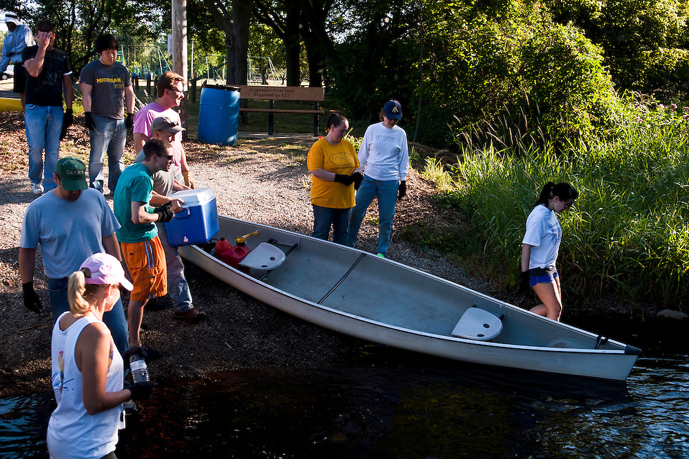 Lathan Goumas | MLive.com..Volunteers enter the Shiawassee River from Bush Park in Fenton, Mich. for an annual cleanup on Saturday, June 23, 2012. A group of approximately 20 volunteers waded 6.1 miles down the river removing trash and debris.