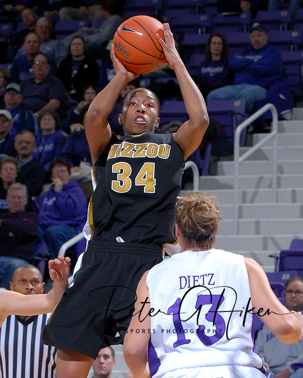 Missouri guard Tiffany Brooks (34) puts up a shot over Kansas State guard Dimberly Dietz (13) during the first half at Bramlage Coliseum in Manhattan, Kansas, January 13, 2007.  K-State beat the Tigers 81-66.