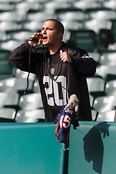 Nov 6, 2011; Oakland, CA, USA; Oakland Raiders fan Don Staben taunts Denver Broncos quarterback Tim Tebow (not pictured) before the game at O.co Coliseum. Denver defeated Oakland 38-24. Mandatory Credit: Jason O. Watson-US PRESSWIRE