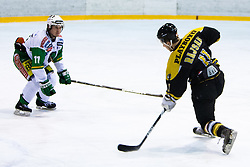 Saso Rajsar of Slavija and Ziga Grahut of Olimpija during ice-hockey match between HK Playboy Slavija and HDD Telemach Olimpija in second game of Final at Slovenian National League, on April 8, 2013 at Dvorana Zalog, Ljubljana, Slovenia. (Photo By Matic Klansek Velej / Sportida.com)