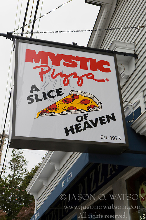 """Mystic Pizza, the restaurant that shares it's name with a popular film, with sign out front that reads """"Mystic Pizza  A Slice of Heaven., est. 1973"""", Mystic, Connecticut."""