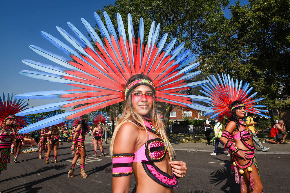 © Licensed to London News Pictures. 26/08/2019. LONDON, UK. Dancers take part in the Grand Finale at the Notting Hill Carnival.  Over one million revellers are expected to visit Europe's biggest street party over the Bank Holiday Weekend in a popular annual event celebrating Caribbean culture.  Photo credit: Stephen Chung/LNP