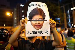 Wanchai, Hong Kong. 26 September, 2019. Demonstrators outside  the Queen Elizabeth Stadium on Thursday where Chief executive Carrie Lam was holding a dialogue with randomly selected representatives from the public to alleviate fears about the now dropped anti extradition law. Iain Masterton/Alamy Live News.