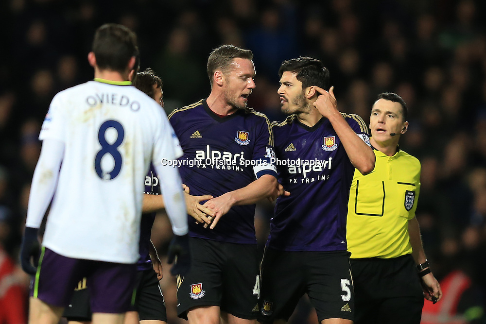 13 January 2015 - The FA Cup 3rd Round (Replay)  - West Ham v Everton - James Tomkins and Mark Noble of West Ham clash as Kevin Nolan tries to intervene - Photo: Marc Atkins / Offside.