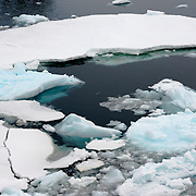 "Pieces of ice on the surface of the water in the Lemaire Channel. The Lemaire Channel is sometimes referred to as ""Kodak Gap"" in a nod to its famously scenic views."