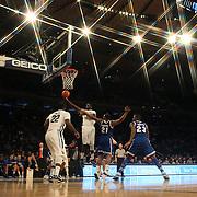 Daniel Ochefu, Villanova, drives to the basket during the Villanova Wildcats Vs Seton Hall Pirates basketball game during the Big East Conference Tournament at Madison Square Garden, New York, USA. 12th March 2014. Photo Tim Clayton