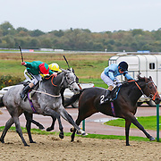 Forgive and S De Sousa winning the 2.50 race