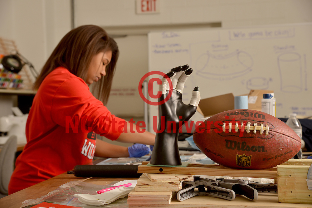 College of Textiles senior Desirae Scruggs works on the next generation of Gryppers.