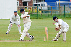 Ross Diver bats for Upper Haugh as (left to right) Steve Reynolds no2 bat Douglas Clack and James Doyle for tickhill look on...19  May 2012.Image © Paul David Drabble